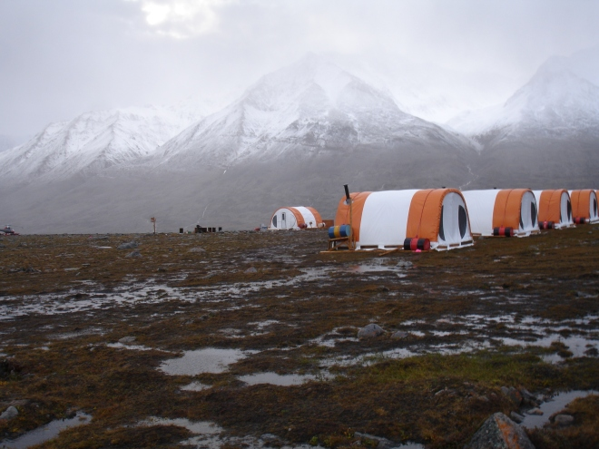Rain clouds over the Stauning Alps of Eastern Greenland after the third day of rain... Exploratory mining camp tents in the foreground.